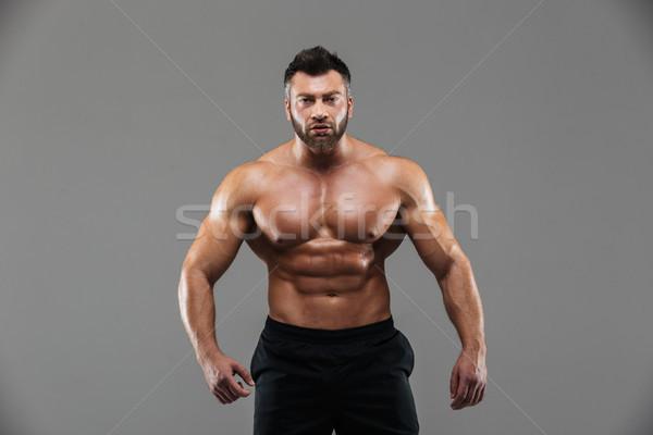 Portre güçlü gömleksiz erkek vücut geliştirmeci ayakta Stok fotoğraf © deandrobot