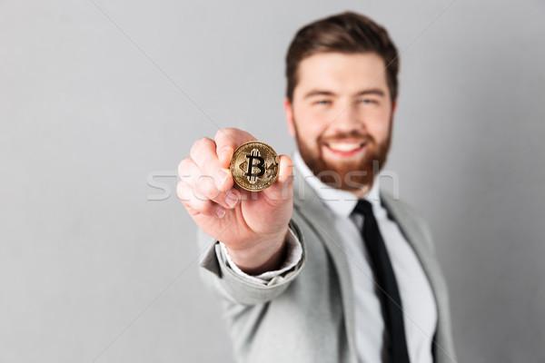 Close up portrait of a smiling businessman Stock photo © deandrobot