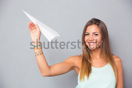 Vertical image of curious woman holding open silver notebook in  Stock photo © deandrobot