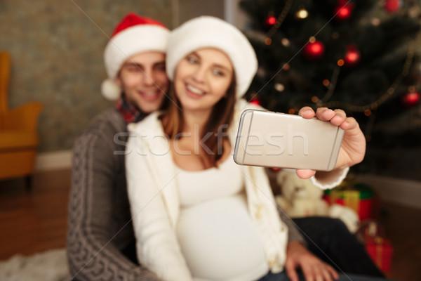 Attrattivo donna incinta marito Natale seduta Foto d'archivio © deandrobot