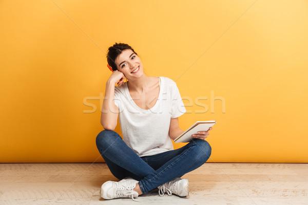 Stock fotó: Portré · boldog · fiatal · nő · tart · notebook · ül