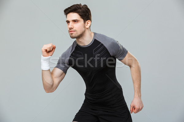 Portrait of a concentrated young sportsman ready to run Stock photo © deandrobot