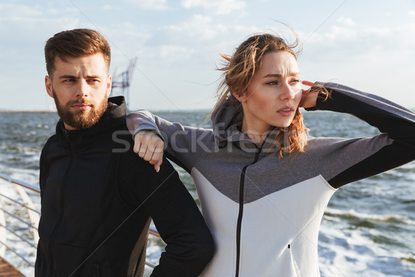 Beautiful young sports couple standing together Stock photo © deandrobot