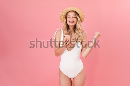 Portrait of a confused young woman dressed in swimsuit Stock photo © deandrobot