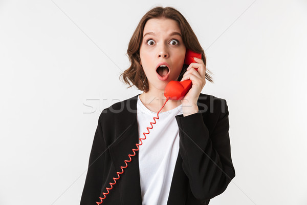 Megrémült fiatal nő áll izolált kép beszél Stock fotó © deandrobot
