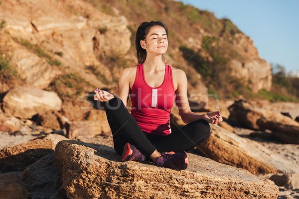 Sonriendo jóvenes sesión yoga posición Foto stock © deandrobot