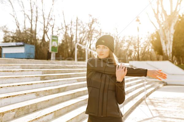 Obraz piękna sportsmenka czarny dres Zdjęcia stock © deandrobot