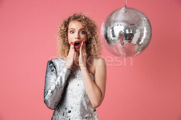 Ritratto scioccato bella donna lucido abito party Foto d'archivio © deandrobot