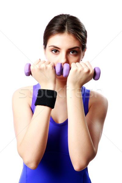 Young sport woman with dumbbells working out isolated on white background Stock photo © deandrobot