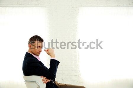 Fashion man sitting on the office chair Stock photo © deandrobot