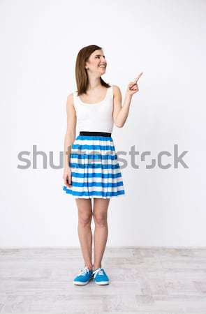 New idea. Happy young woman holding her thumb up Stock photo © deandrobot