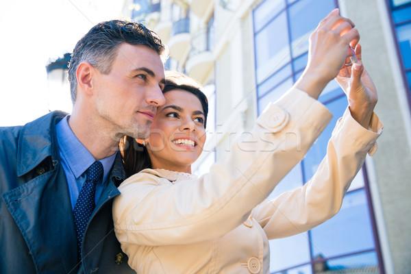 Happy couple making selfie photo Stock photo © deandrobot