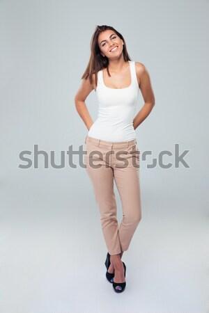 Teljes alakos portré boldog nő felfelé néz szürke Stock fotó © deandrobot