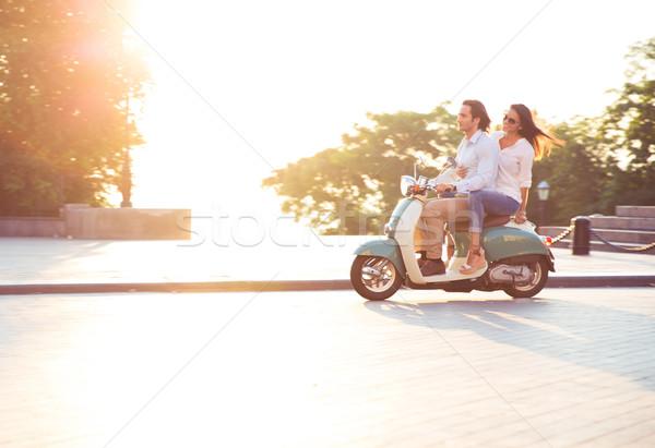 Fiatal pér lovaglás moped szórakozás nap ragyogó Stock fotó © deandrobot