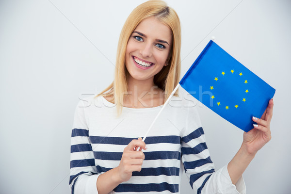 Patriotic woman holding european flag Stock photo © deandrobot