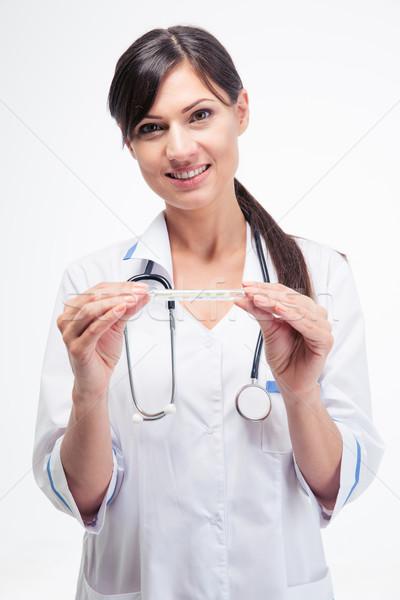 Boldog orvos tart klinikai hőmérő női Stock fotó © deandrobot