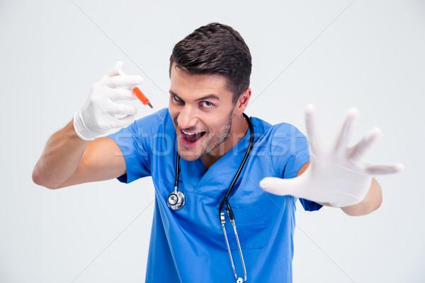 портрет смешные мужской доктор шприц изолированный белый Сток-фото © deandrobot