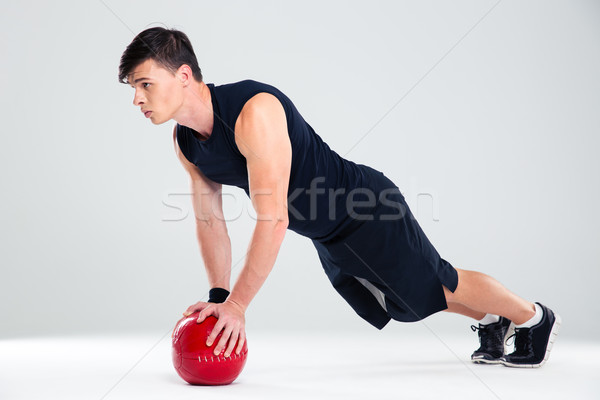 Handsome man workout with fitness ball Stock photo © deandrobot