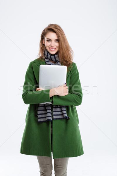 Feliz mulher verde casaco laptop Foto stock © deandrobot