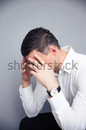 落ち込んで 若い男 携帯電話 目 ハンサム ストックフォト © deandrobot
