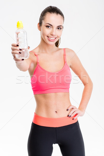 Attractive content young sportswoman giving a bottle of water Stock photo © deandrobot