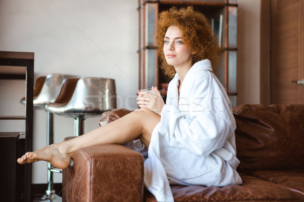 Aantrekkelijk nadenkend vrouw witte badjas vergadering Stockfoto © deandrobot