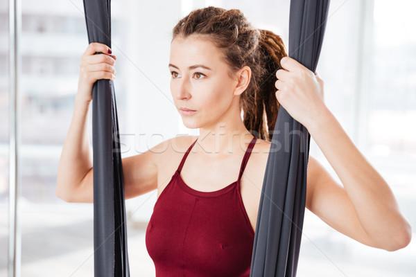 концентрированный женщину гамак йога студию довольно Сток-фото © deandrobot