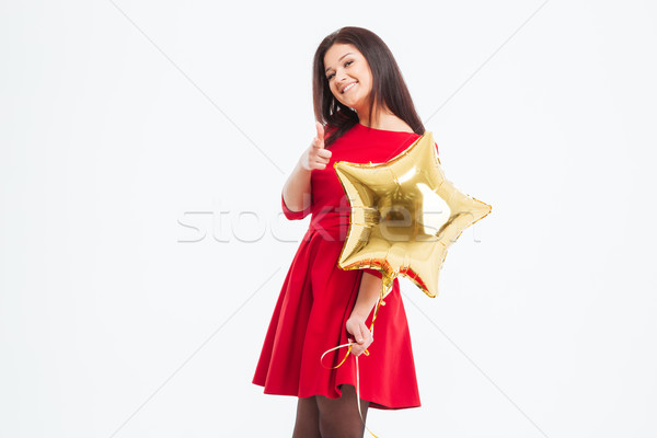 Woman holding balloon and showing finger at camera Stock photo © deandrobot
