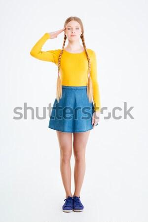 Full length portrait of a woman saluting Stock photo © deandrobot