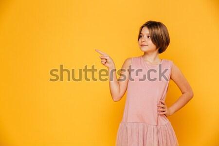 Pensive woman in bright cloth  Stock photo © deandrobot