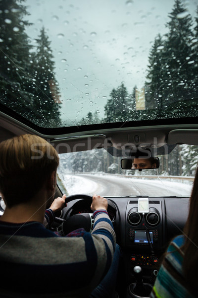 Young couple driving in winter forest Stock photo © deandrobot