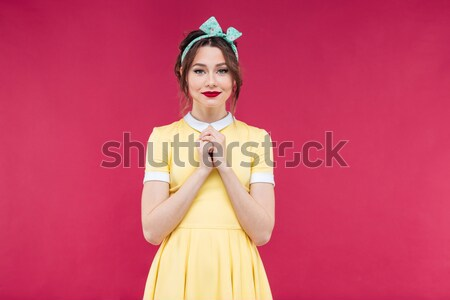 Happy beautiful pinup girl blowing a bubble gum balloon Stock photo © deandrobot