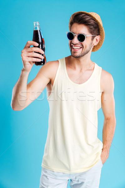 Gülen adam şapka güneş gözlüğü şişe Stok fotoğraf © deandrobot