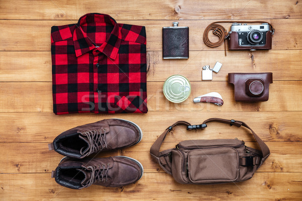 Travel concept boots, shirt, camera, lighter, flask, bag, penkni Stock photo © deandrobot