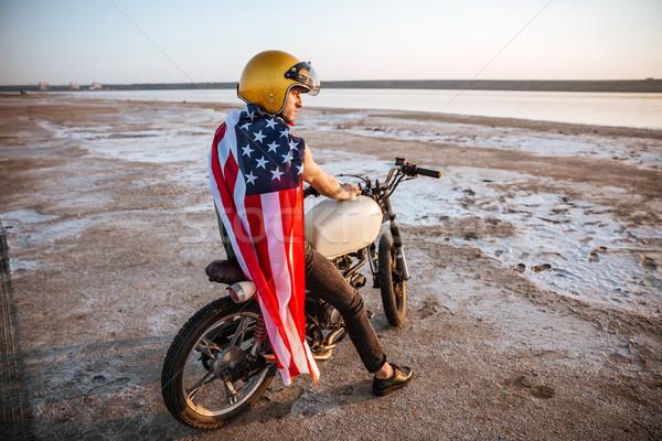 男 アメリカン 座って 小さな 残忍な ストックフォト © deandrobot