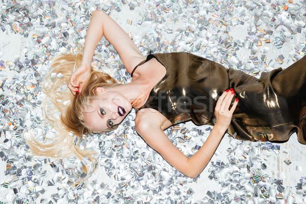 Sensual young woman with gothic makeup lying Stock photo © deandrobot