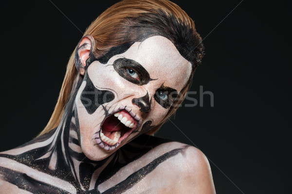 Woman with frightened halloween makeup and opened mouth shouting Stock photo © deandrobot