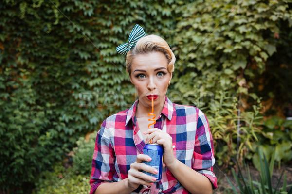 Bonitinho atraente menina potável soda Foto stock © deandrobot