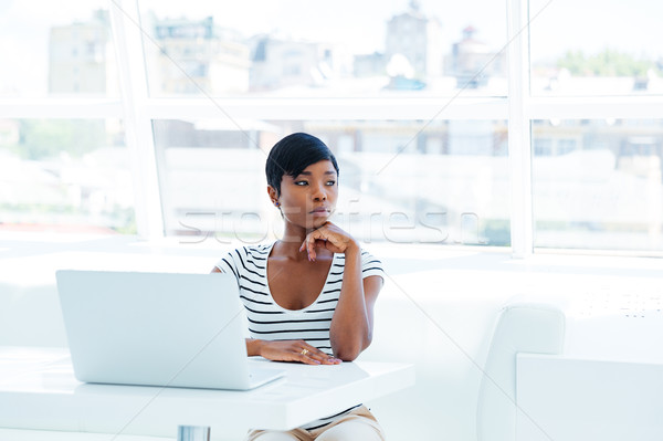 Portrait of a serious thoughtful businesswoman using laptop in office Stock photo © deandrobot