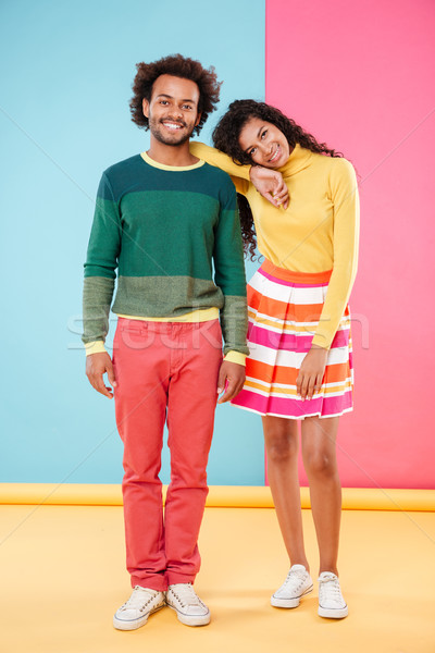 Full length of happy tender young couple in bright clothes Stock photo © deandrobot
