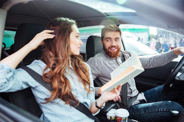 Happy couple in car Stock photo © deandrobot