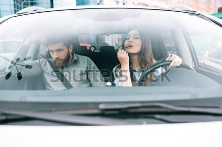 Woman yells at man in car Stock photo © deandrobot