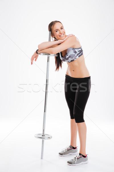 笑みを浮かべて フィットネス 少女 バーベル 孤立した ストックフォト © deandrobot
