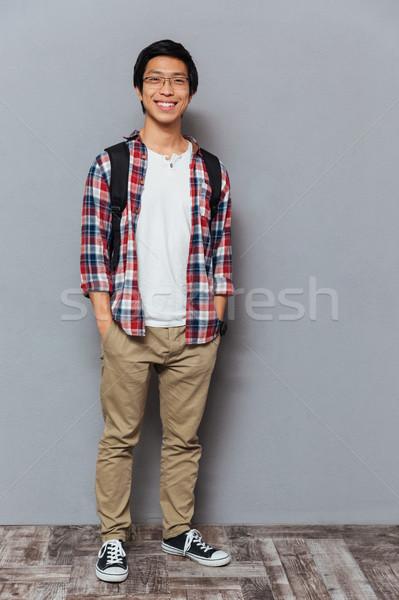 улыбаясь азиатских человека рюкзак Постоянный , держась за руки Сток-фото © deandrobot