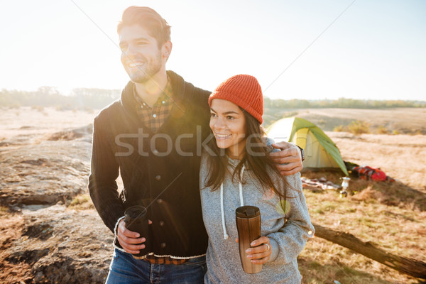 Couple standing near the tent Stock photo © deandrobot