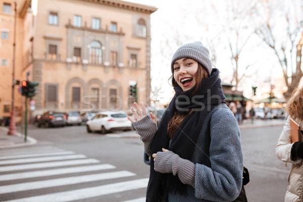 Mutlu genç kadın ayakta merhaba jest Stok fotoğraf © deandrobot