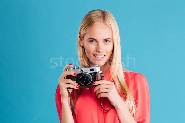 Portrait of a cheerful woman making photo on camera Stock photo © deandrobot