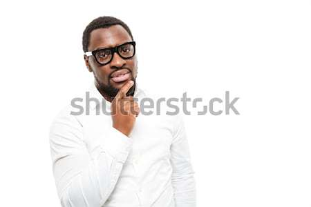 Stock photo: Serious young african man standing isolated over white background.