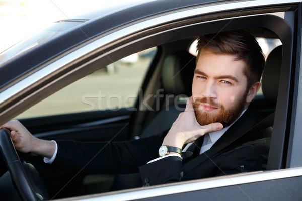 Zamyślony człowiek biznesu strony podbródek jazdy Zdjęcia stock © deandrobot