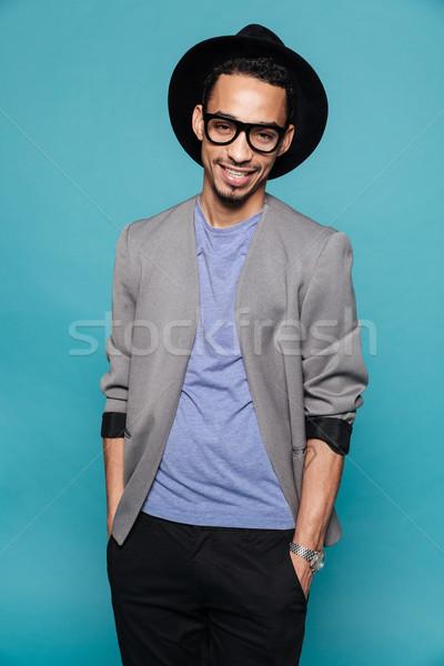 笑みを浮かべて アフリカ 男 眼鏡 立って 手 ストックフォト © deandrobot